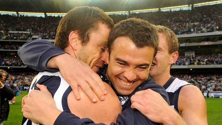 A hug from coach Chris Scott after last year's grand final.
