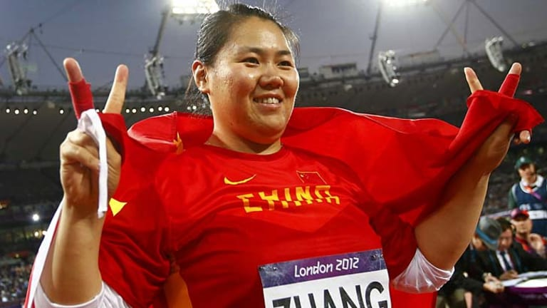 Going early .... China's Zhang Wenxiu celebrates after initially thinking she'd won the bronze medal.