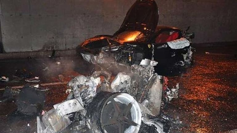 Tragedy ... the incinerated Ferrari in which Ling Gu died.