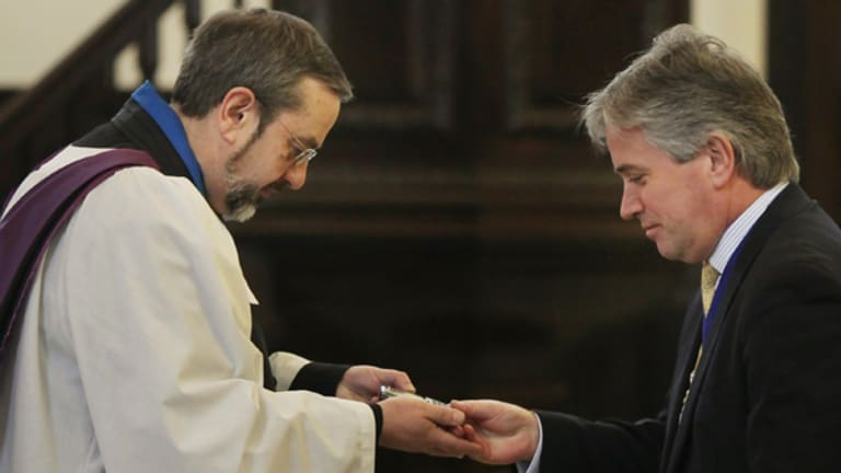 Unusual ceremony ... The Lord Mayor of London Nick Anstee, right, has his mobile phone blessed.