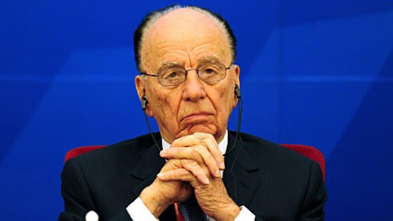 Opportunity knocks... Rupert Murdoch urged Beijing to open the digital door to the future.