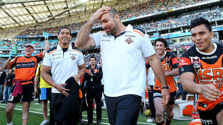 Tigers coach Todd Payten celebrates after winning the Toyota Cup grand final against the Canberra Raiders.