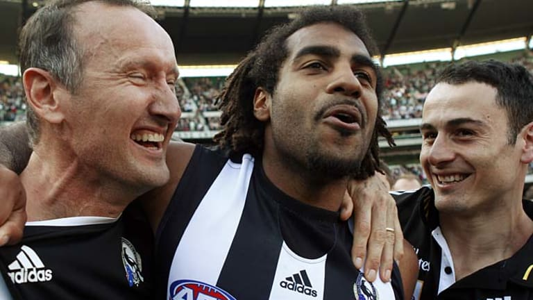 It has taken Magpies fitness coach David Buttifant, seen here with defender Harry O'Brien and assistant Paul Licuria after the 2010 premiership win, two years to convince the club that the mid-season trip is worthwhile.