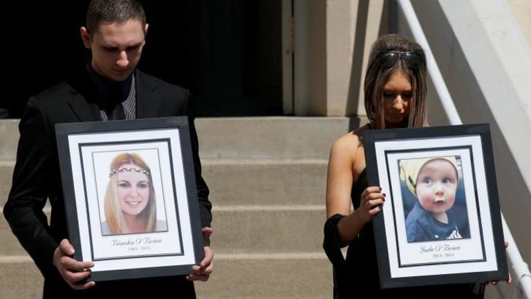 Killed in the blast: relatives of Bianka and Jude O'Brien carry their photographs at their funeral.