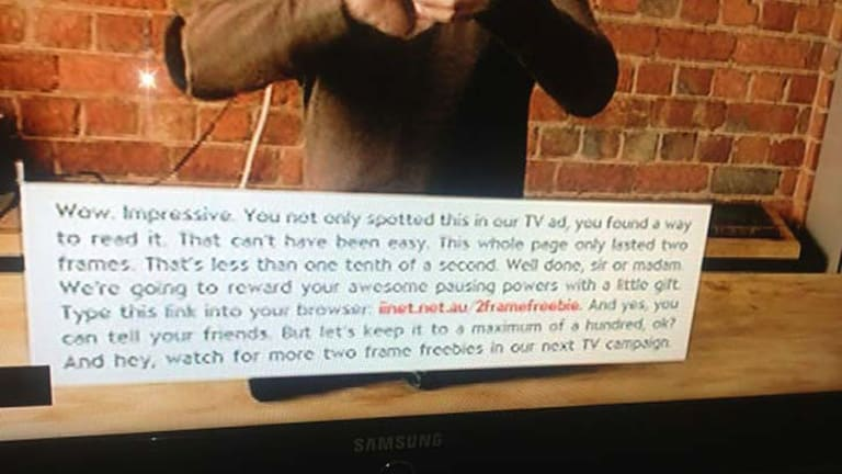 A grab from iiNet's ad ... the message can only be read when the TV is paused.