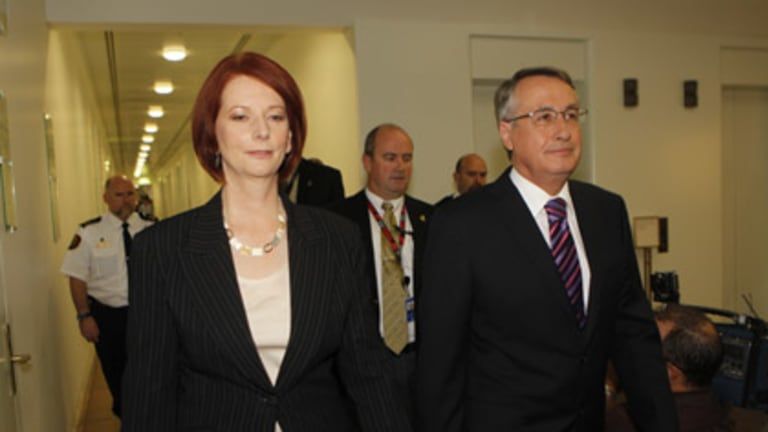 Julia Gillard and Wayne Swan enter today's Labor caucus meeting.
