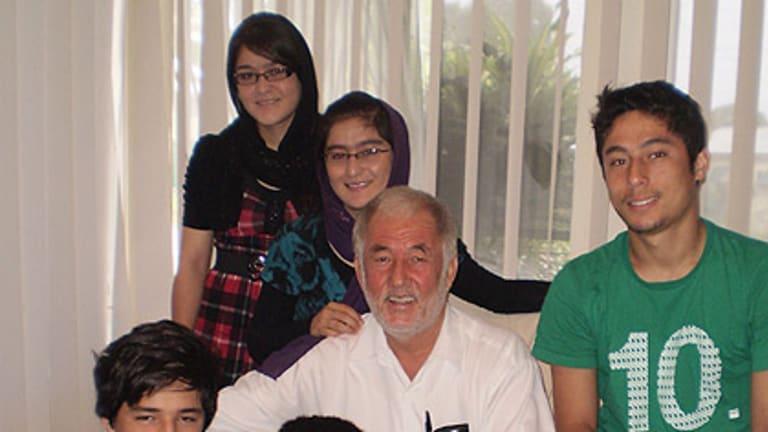 The Karimi family in their Dutton Park home. (from top left) Farida, 19, Sediqa, 21, their father Ali, Elias, 18, Murtaza, 13, and Edris, 16.