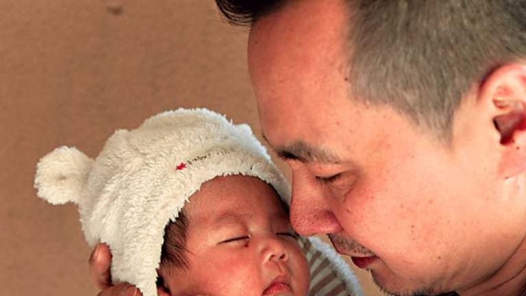 Devastated ... Jason Zheng with two-month-old Alexander.