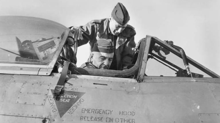 Kimpo, South Korea 1951, Air Vice-Marshall J.P.J McCauley, Air Officer Commanding Eastern Area, RAAF, in the cockpit of a meteor aircraft of No. 77 Squadron, with Wing Commander G. Steege, Commanding Officer No. 77 Squadron.