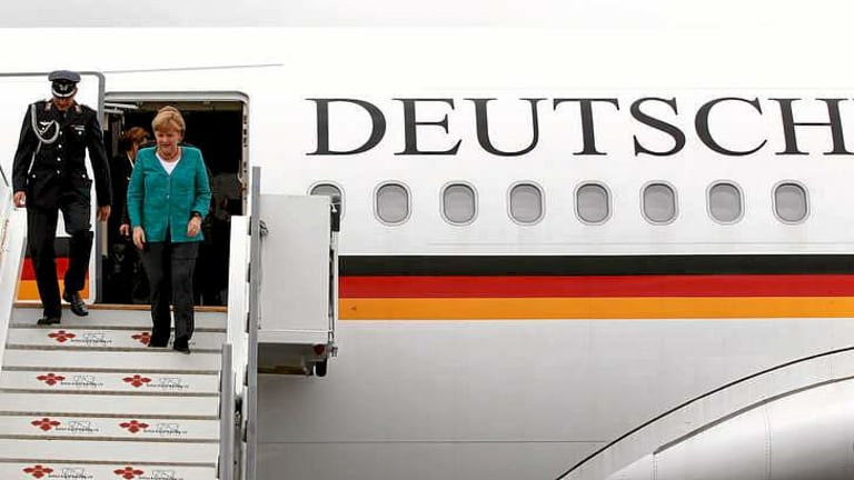 German Chancellor Angela Merkel disembarks from a plane as she arrives in Northern Ireland in June.