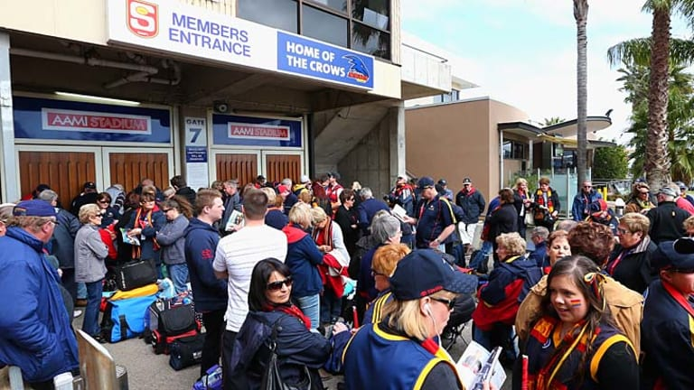 Crows fans queue outside the stadium before the Second Qualifying Final.