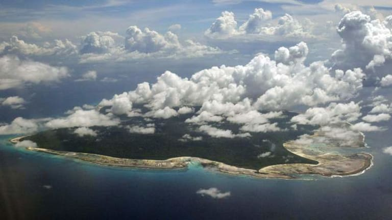 India used heat sensors on flights over hundreds of Andaman Sea islands such as North Sentinel Island and will expand its search for the missing Malaysia Airlines jet farther west into the Bay of Bengal, officials said.