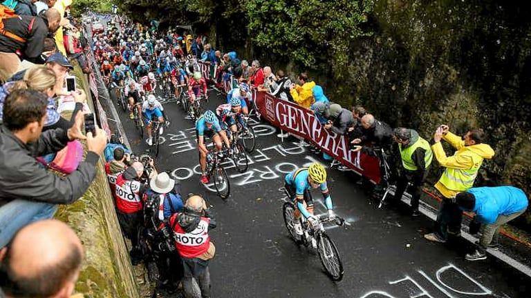 Jan Bakelants of Belgium leads the peloton up the climb.