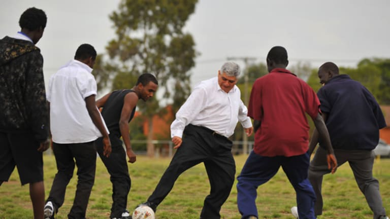 James Demetriou, who runs the not-for-profit charity Sports Without Borders, plays soccer with a team of young African refugees.