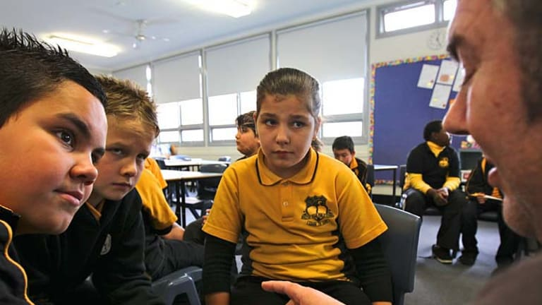 Students attend an ethics class at a primary school in Sydney. Upper House MP Fred Nile is pushing to have the classes, which provide an alternative to religious instruction, removed from public schools.