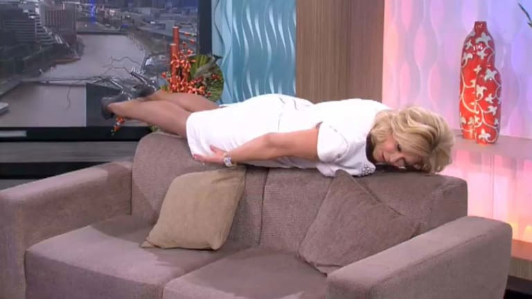 """Kerri-Anne Kennerley """"planking"""" on her morning show."""