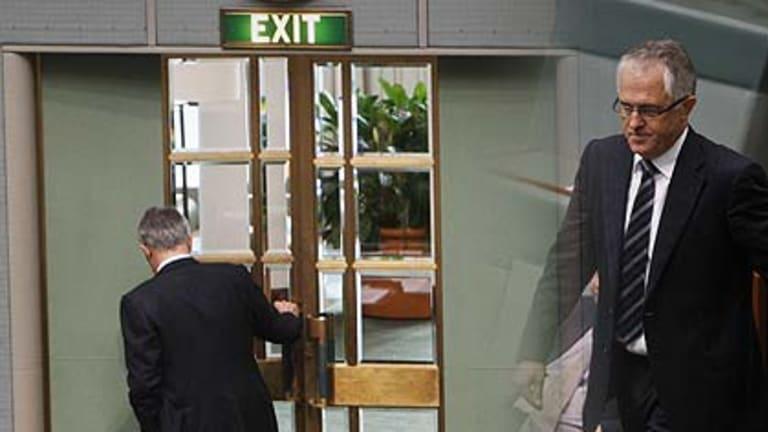 Malcolm Turnbull crosses the floor before leaving the chamber.