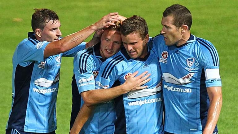 Breakthrough … Jason Culina, second from right, is swamped after scoring for the Sky Blues against Perth on Saturday night.