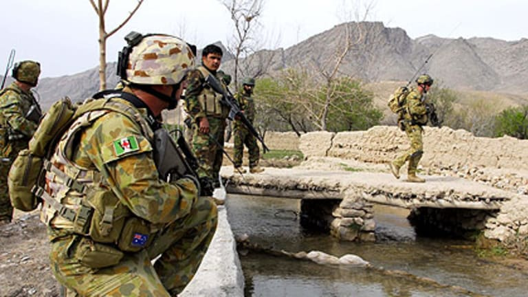 Soldiers on patrol in the Baluchi Valley, Afghanistan, where two more Australians were wounded on Saturday.