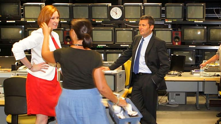 Changing of the guard . . . Leigh Sales, left, and Chris Uhlmann provided some compelling television on the ABC's new <i>7.30</i> current affairs show.