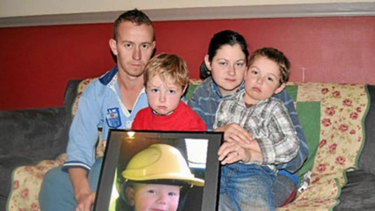 Grieving ... Sarah and Graeme Williams with sons Bailey and Jack. The Williams have lodged a complaint with NSW Ambulance Service.