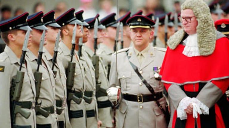 Guard of honour...Sir Noel inspects British troops.