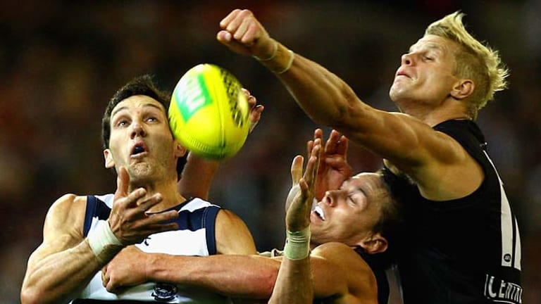 Fist of fury: St Kilda's Nick Riewoldt (right) attempts to spoil Geelong's Harry Taylor at the MCG on Friday night.
