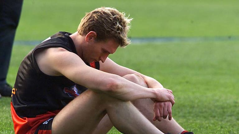 Essendon's James Hird is dejected after the 2001 grand final.
