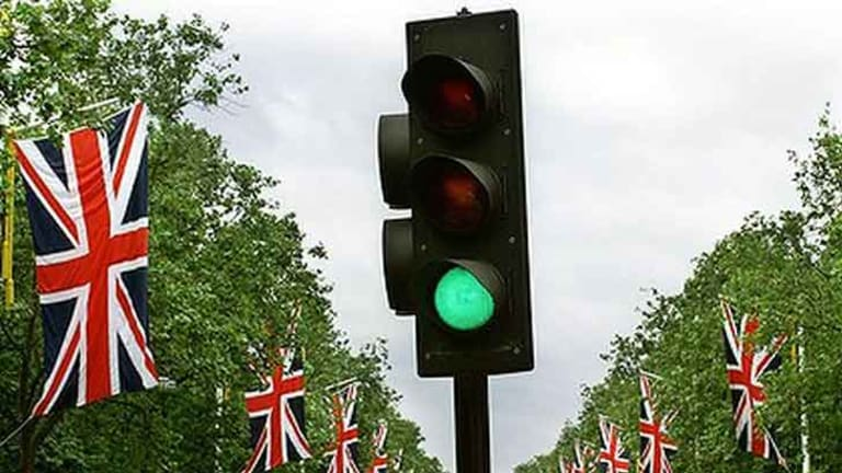 Traffic lights in England turn amber before they turn green.