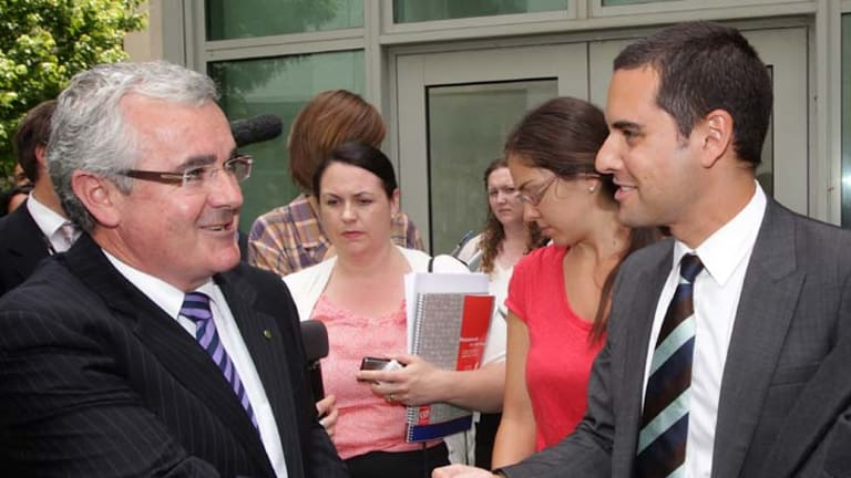 L-R: Independent MP Andrew Wilkie shakes hands with Australian Marriage Equality national convener, Alex Greenwich, at the end of a doorstop commenting on same-sex marriage at Parliament House Canberra.