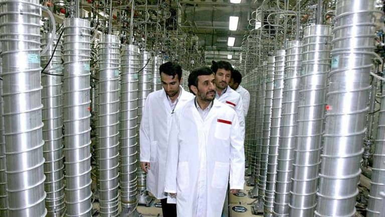Iranian President Mahmoud Ahmadinejad, seen here at a uranium  facility in 2008, has a difficult task ahead as international sanctions take effect.