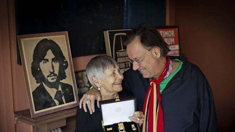 June Stewart and son Paul with a portrait of Tony.