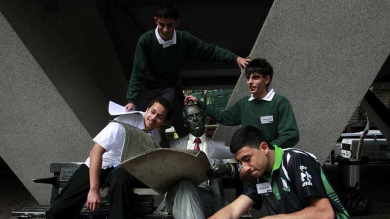 Fostering the future ... Mahdi Saleh, front, with his Airds high school classmates. The group are taking part in a treasure hunt in the city designed by mentors at Aussie Home Loans.