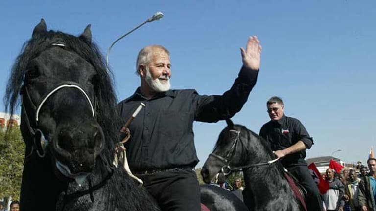South African white supremacist Eugene Terre'Blanche  rides a black horse after being released from prison in Potchefstroom  on June 11, 2004.