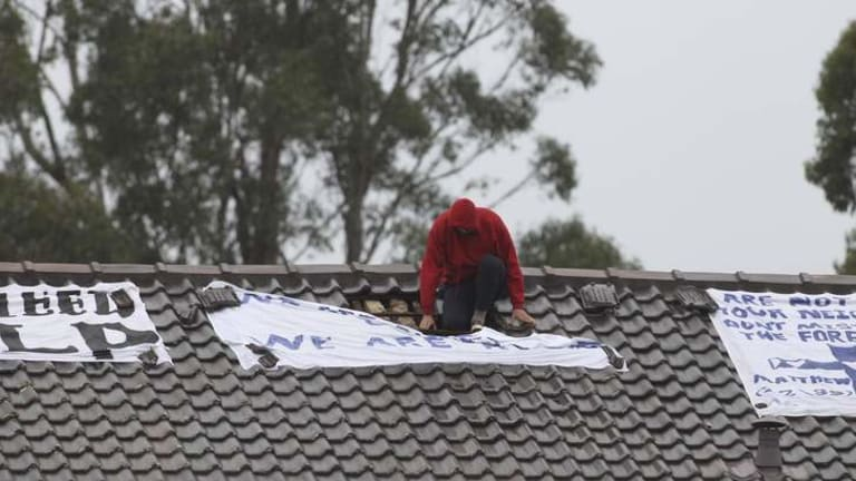 A protester on the roof of the detention centre at Villawood in 2011.
