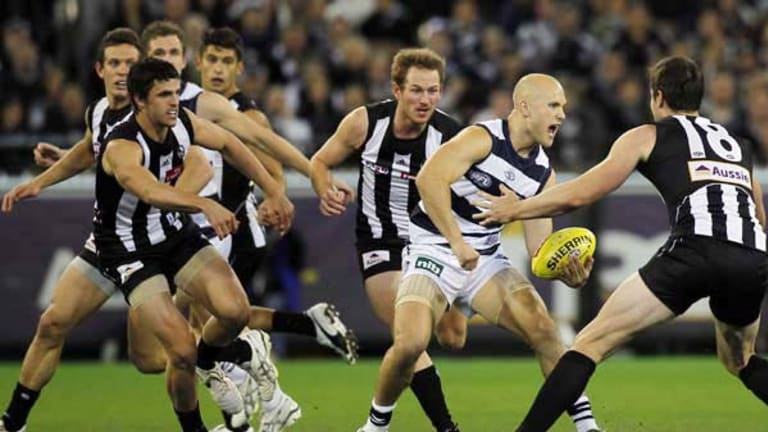 Gary Ablett looks to elude a pack of Magpies when the teams met in round 9 this season.