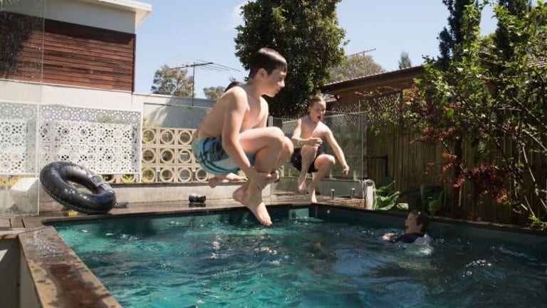 Bombs away: Pollen counts aren't the only things on the rise. Fletcher Youens (left) and Will Martin make a splash at the home of friends Aloysius and Xavier Zadro.
