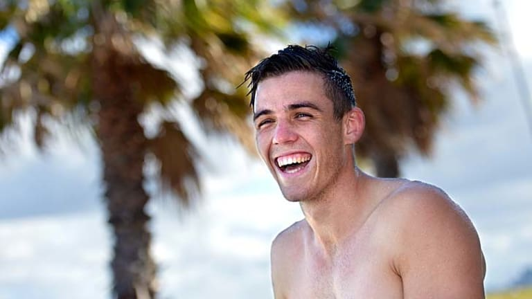 Laughing: Paul Seedsman can't believe his luck, playing for his beloved Collingwood.