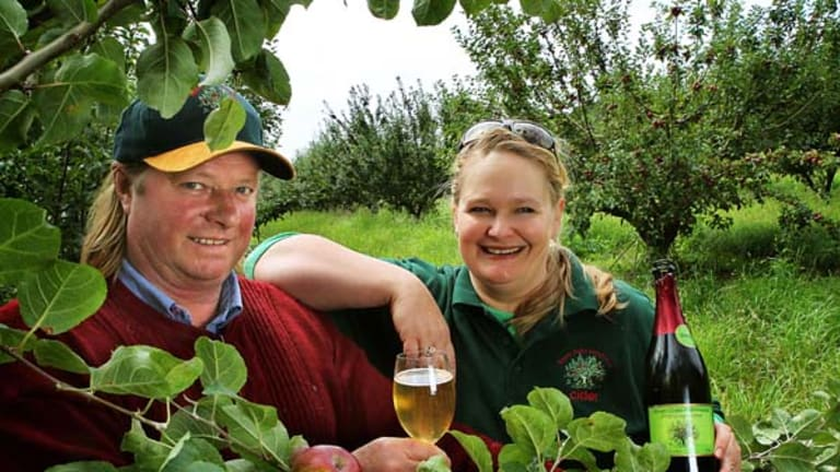 Apple grower Sid Cairns and Cider maker Lisa Cresswell with a tree of ripe Kingston Blacks at Seven Oaks Farmhouse Cider Orchard.