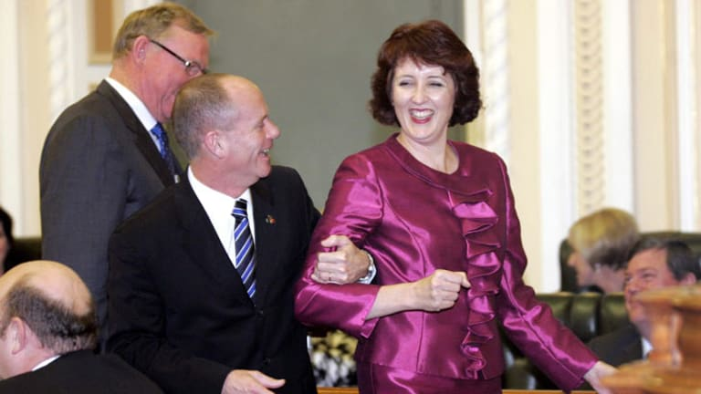Premier Campbell Newman leads Fiona Simpson to the Speaker's chair.
