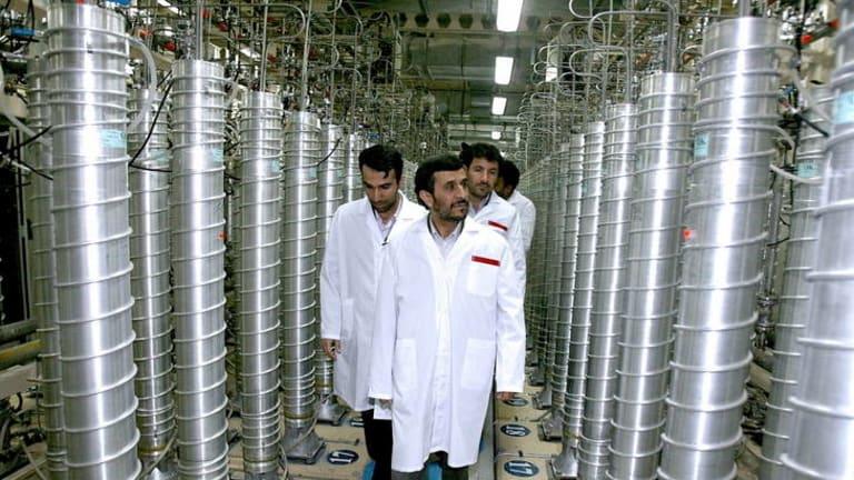 Sabotage ... the Iranian President, Mahmoud Ahmadinejad, examines gas centrifuge cascades at the Natanz  nuclear facility.