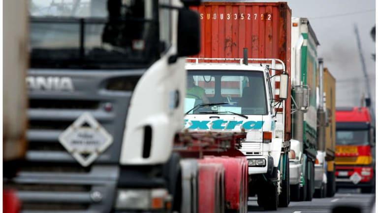 Trucks travel along  Francis St Yarraville.