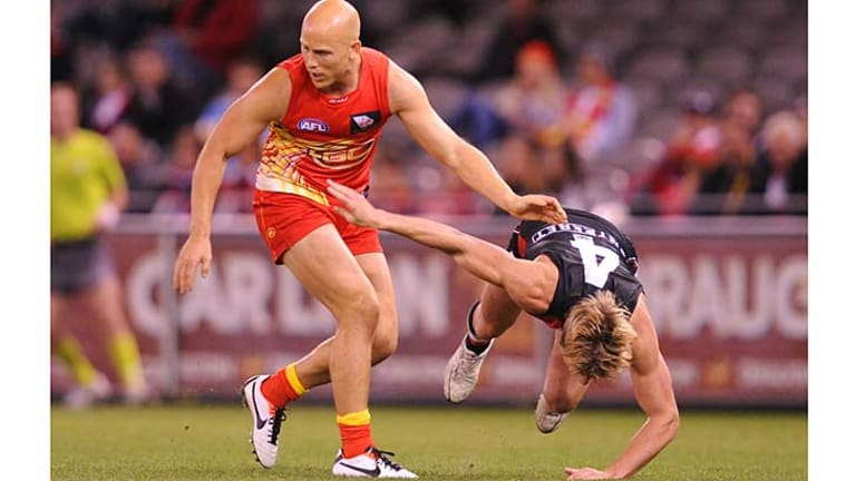 Falling into place: Suns star Gary Ablett gets rid of St Kilda tagger Clinton Jones during Sunday's game at Etihad Stadium.