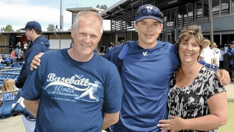 Take me out to the ball game … Lewis Thorpe with his parents, Ross and Lyn, earlier this year.
