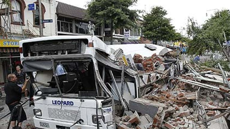 A bus crushed by falling building debris in Christchurch.