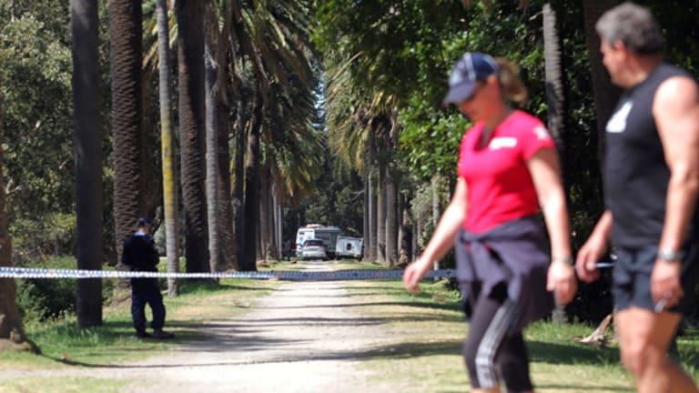 Police investigate a body found in Centennial Park.