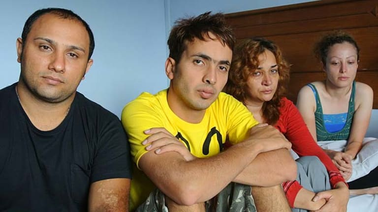 Benyamin Saber (centre), 28, with some of the other 46 Iranian asylum seekers at the  hotel in Merak, Indonesia, where they are being detained after being rescued 110 nautical miles off Christmas Island.