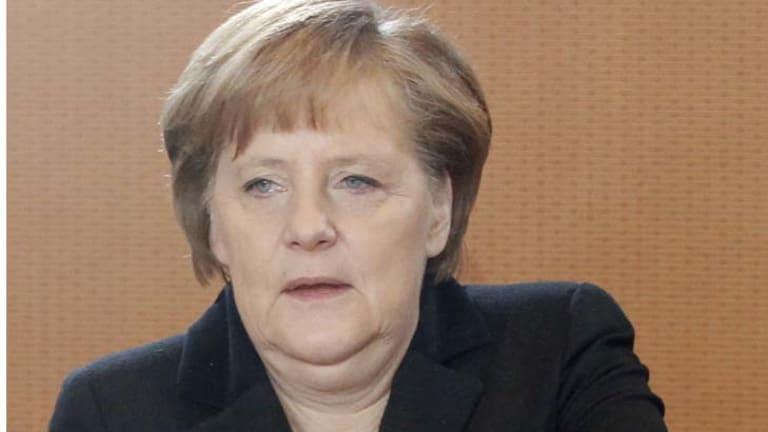 """We haven't overcome the crisis yet"" ... German Chancellor Angela Merkel."