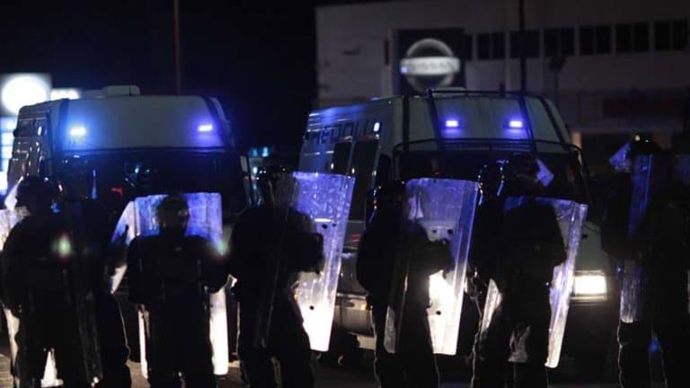 Certainty v chaos ... riot police in Eltham, London, deter vigilantes.