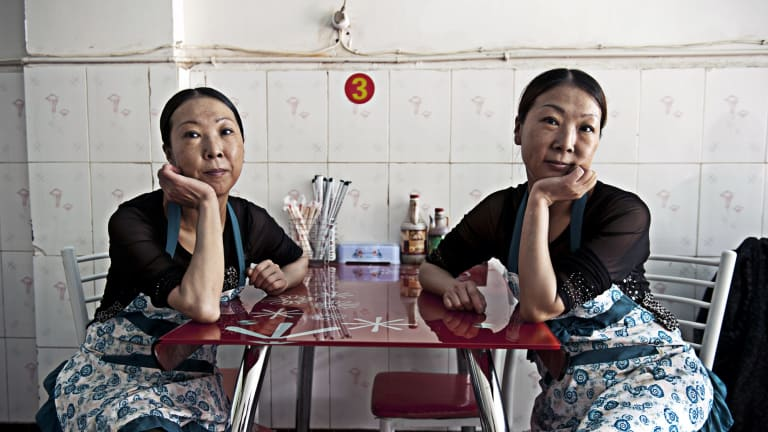SHOOT THE CHEF 2013 The sisters Jin by Hugh Rutherford  I came across these two delightful twin sisters, Ying and Lan, who run the Chong Quing Twins Restaurant in Mianning County, Sichuan Province. They recommended their homemade rice noodle soup.?